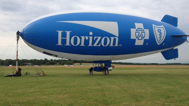 The Horizon Blue Cross Blue Shield of New Jersey Blimp makes a safe landing at Solberg Airport in Readington.