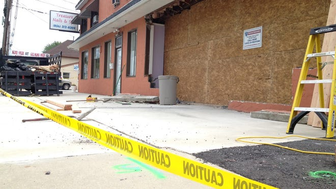 A building on the 100 block of East Browning Road in Bellmawr was boarded up after a van crashed through it early Sunday.