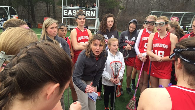 Haddon Township lacrosse coach Julie Sullivan talks to her team during a recent game against Eastern.