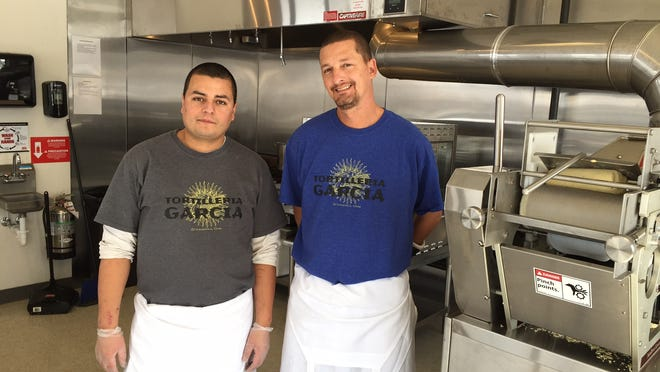Omar Garcia (left) and Toby Stoller, two of the owners of Garcia Tortilleria in Springdale