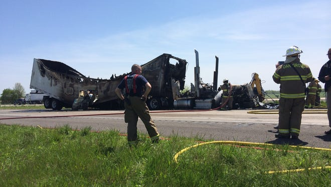 A tractor-trailer burned on the side of Interstate 24 Thursday afternoon following a three-vehicle wreck.