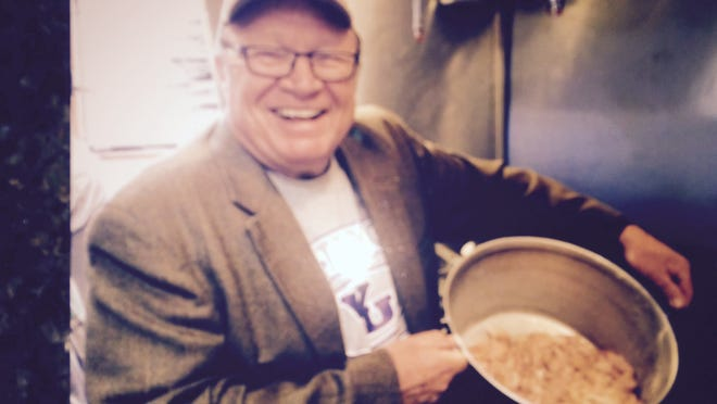 Jim Voigt, one of the sponsors of Whittemore's annual nut fry, holds a pan of...um...jewels ready to cook up.