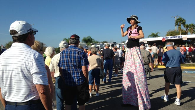 Balloon artist Torrie Heathcoat entertains the crowd in line before the RV show.