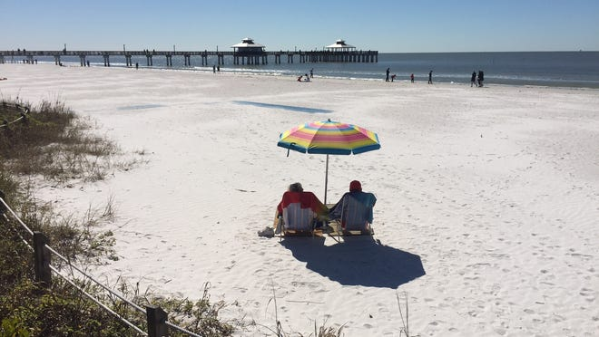 Dick and Dawn Wethal on vacation from Wisconsin had the only umbrella on the beach at 11 a.m. on Friday at Lynn Hall Park. It would normally be packed during this time of year.