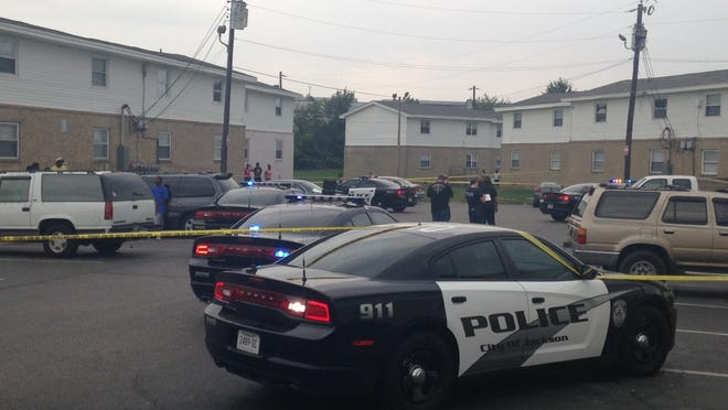 Several police officers gather in the parking lot at Parkway East Apartments, at 33 Carver Ave., after two people were shot Sunday afternoon. Shomari Peterson Jr., 17, later was pronounced dead. The other man remains hospitalized in stable condition.
