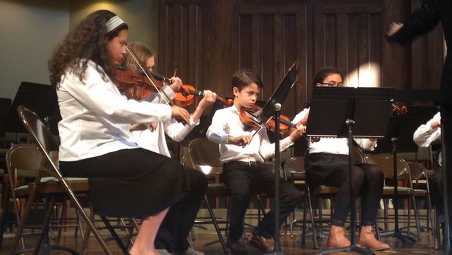 Perfromers with the Sinfonia String Ensemble of the Jackson Symphony Youth Orchestra perform Sunday at First Baptist Church in Jackson.