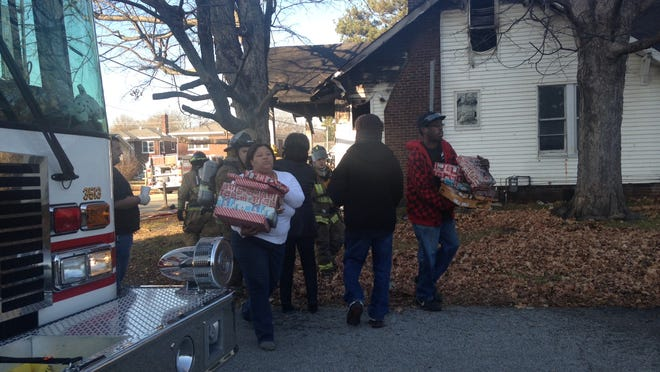Jackson firefighters saved Christmas gifts and returned them to the family who lives in a home on the 100 block of South Fairgrounds Street that caught fire Friday afternoon.