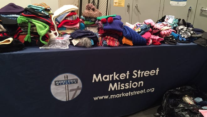Thousands of coats were donated for the Market Street Mission's 24th Annual Coat Giveaway on Sat., Nov. 1, 2014. Scarves, hats and gloves were also collected and distributed.