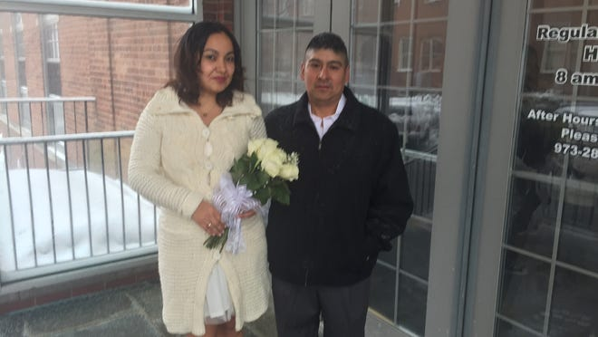 "Itzel Guerrero and Alfredo ""Carlos"" Tamay of Morristown got a snowy morning to get married Thursday by Morris County Clerk Ann Grossi."