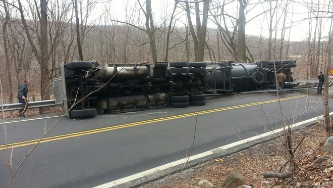 Green Pond Road is closed in both directions after a tractor trailer heading north overturned.