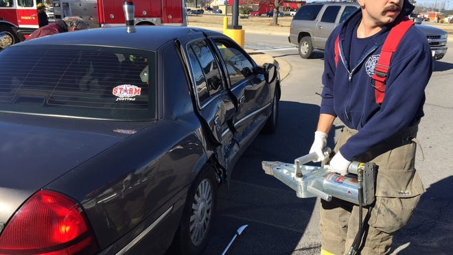 A Mountain Home firefighter prepares to use the Jaws of Life to free Melody Langford, 68, from a four-door Mercury sedan after an accident just before noon. Paul Langford, 70, was driving the car and had turned from U.S. Highway 62 onto Paul Wood Lane next to Popeye's when it was struck by a Chevrolet Suburban driven by April Maddock, 35. Along with the Mountain Home Fire Department the Mountain Home Police Department was on the scene.