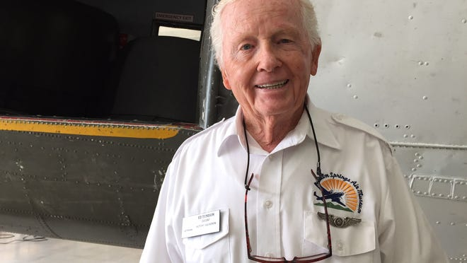 World War II U.S. Army Air Corps Veteran Ed Tunison, a docent at the Palm Springs Air Museum, poses by the museum's C-47 on Dec. 8.