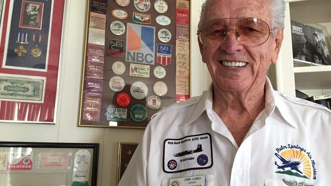 Korean War veteran John James stands near a display of memorabilia from his military days and his years as head cameraman at NBC.