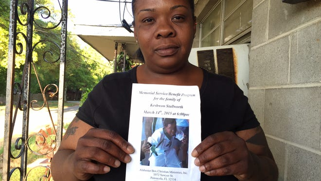 Sheronda Sheard holds a program from her son Keshwon Stallworth's memorial service. Forensics have confirmed that 16-year-old Stallworth was killed and burned in a car fire March 6 in Pensacola.