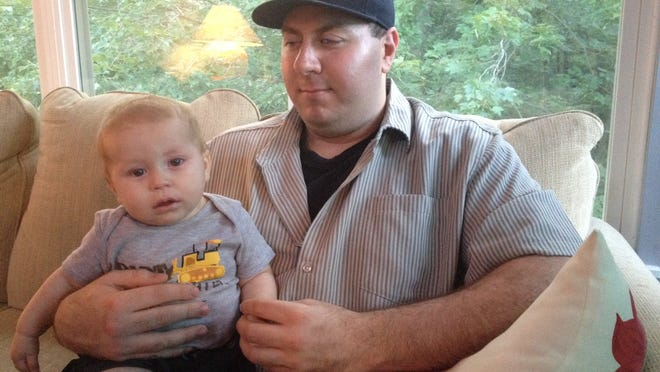 Louis DeCosmo, a Town of LaGrange resident, with his 8-month-old son, Jaxon.