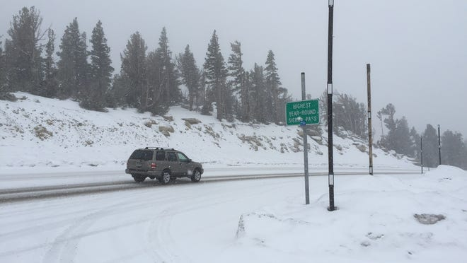 A car travels over Mount Rose Summit during a snowstorm Jan. 27. Another storm is expected to bring snow to the region Friday and Saturday, with Reno getting its first significant snowfall in 2015.