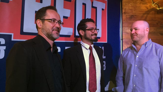Co-organizers Remi Jourdan (from left), Baldo Bobadilla and Flip Wright get ready to announce the Off Beat Arts & Music Festival at Chapel Tavern in Reno.