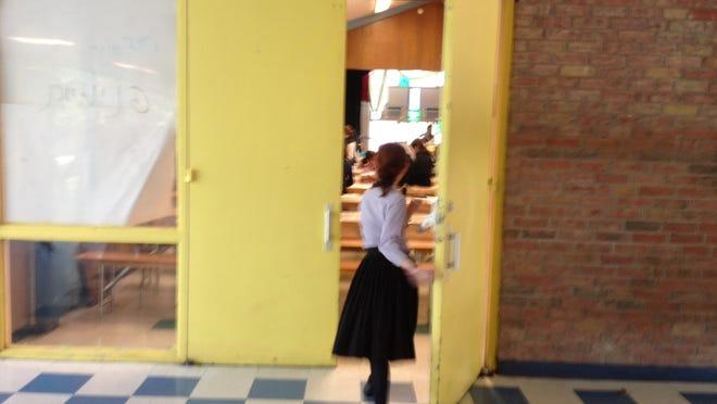 An Avir Yakov yeshiva student enters the auditorium inside Hillcrest Elementary in 2013.