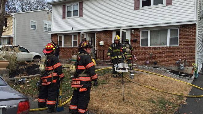 Firefighters on the scene of a fire that started in the kitchen of a Hester Place home in Garnerville on Thursday, Dec. 11.