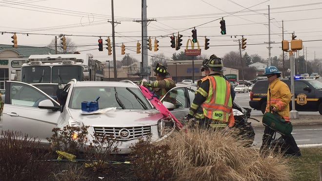 Emergency crews respond to a two-vehicle crash at Limestone Road and Kirkwood Highway Thursday afternoon.