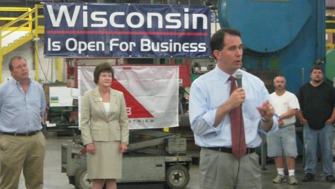 Gov. Scott Walker addresses employees at G3 Industries in Kronenwetter. Walker visited to promote improved jobs numbers in Wisconsin in 2012.