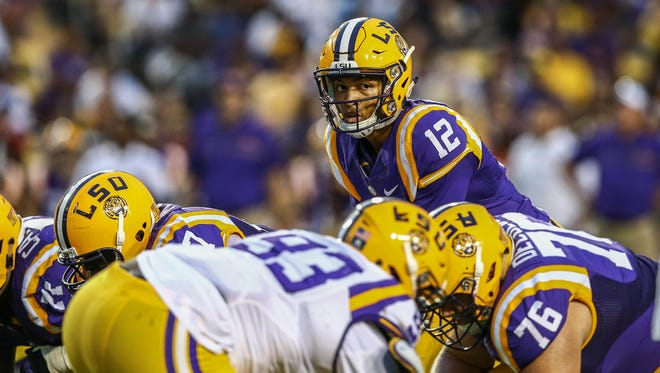 Apr 22, 2017; Baton Rouge, LA, USA; LSU Tigers quarterback Justin McMillan (12) calls a play at the line during the second quarter of the annual LSU Tigers purple-gold spring game at Tiger Stadium. Mandatory Credit: Stephen Lew-USA TODAY Sports