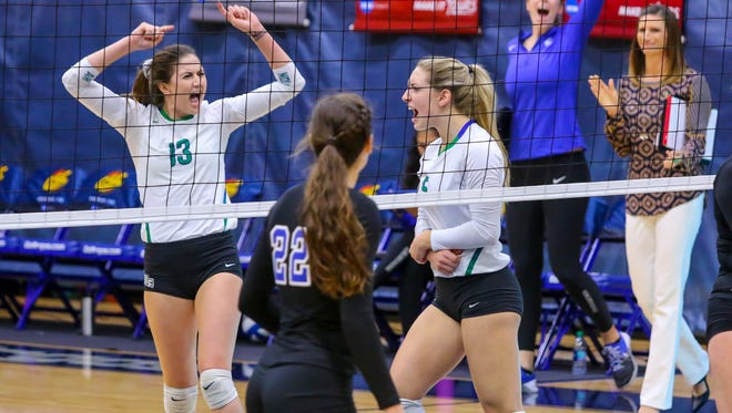 West Florida's Rachel Neblett (13) and Jordyn Poppen (5) celebrate after Poppen scored a point against Shorter University during the Gulf South Conference semifinal volleyball game at UWF on Saturday, November 18, 2017.  The Argos won the match in three straight sets and will play for the conference championship at tomorrow at 2 p.m. at the UWF Field House.