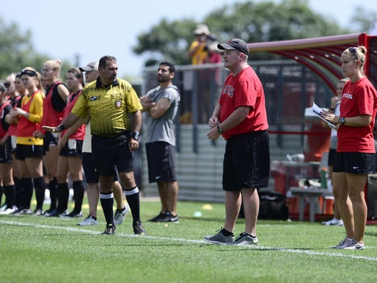 Rutgers women's soccer coach Mike O'Neill (front, right) hired former star Meghan Ryan (back, right) to be his top assistant when he was promoted from within.