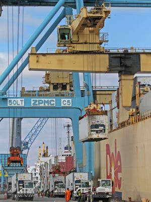 Longshoremen help unload a Dole shipment  at the Port of Wilmington on March 5, 2013. Port officials hope to expand shipping operations on the Delaware River.