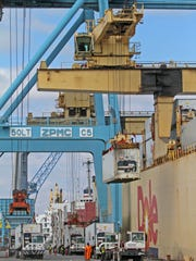 Longshoremen help unload a Dole shipment from a ship at the Port of Wilmington on March 5, 2013.