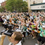Fans and media packed Main Street in Cortland in 2013 to welcome Jets players and coaches to training camp.