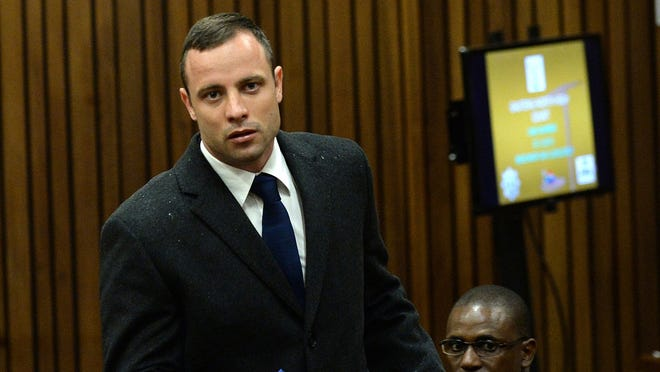 Oscar Pistorius enters court on the second day of his trial.