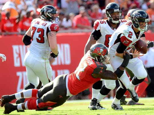 Tampa Bay defensive end William Gholston sacks Atlanta Falcons  quarterback Matt Ryan (2) in December, one of a career-high three sacks last season for the former MSU standout.
