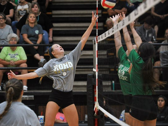 Saige Ward of Rider taps the ball over two Iowa Park