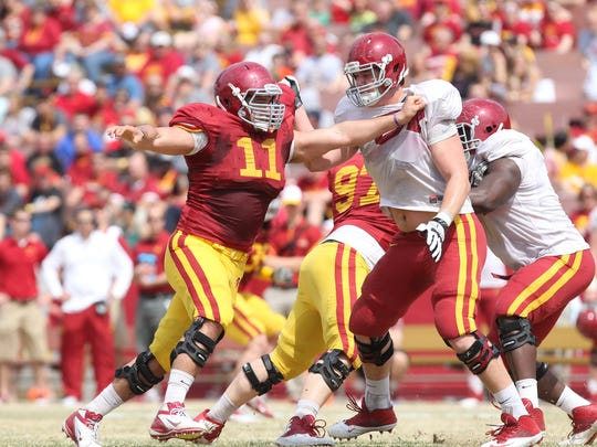 Defensive end Gabe Luna (11) works to get around Jake Campos during Iowa State's spring scrimmage in April.