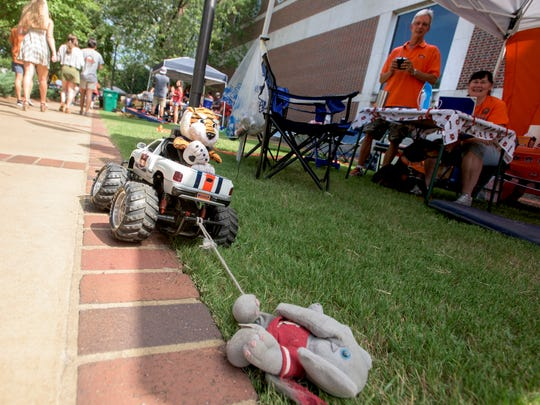 Richard Sisson uses a remote control car to drag an Alabama mascot before the Auburn vs. Clemson game in Auburn, Ala., on Saturday September 3, 2016.