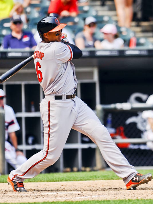 Baltimore's Jonathan Schoop hits a single during the seventh inning against the Chicago White Sox in Chicago on Sunday. Schoop also homered in his first at-bat since coming off the 60-day disabled list in the Orioles' 9-1 victory.