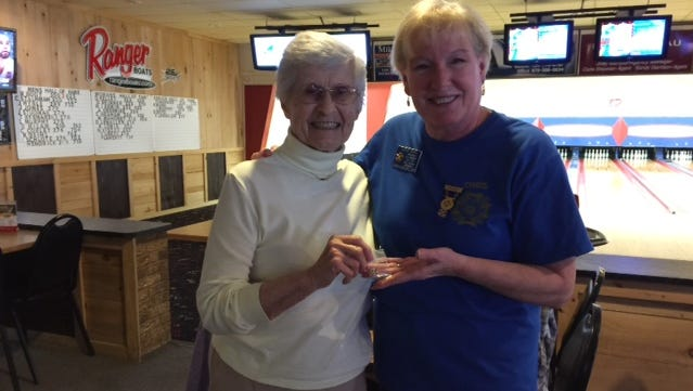 From left, Elaine Bitout of Lakeview receives her 45 year membership pin in the Bull Shoals VFW Hoevel-Barnett Post 1341 Auxiliary. Chris Ross, auxiliary president, presents the pin.
