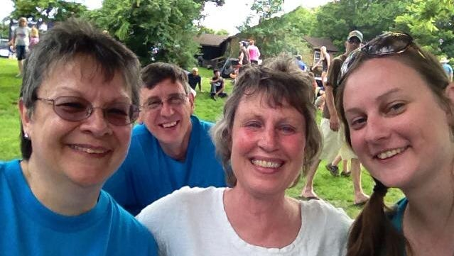 Stephanie Dickrell, right, is shown at Monticello's Riverfest community celebration in 2013, with her parents, Mary Micke, left, and Jim Dickrell. Lana Gilberts, mother of Stephanie's best friend Paula and second mother to Stephanie, is in the middle.