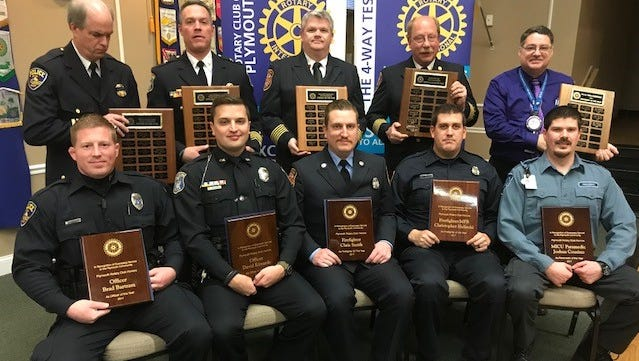Award recipients in the front row are Brad Bartram, David Edwards, Chris Smith, Chris Helinski and Josh Cousino. Behind them are public safety officials Tom Tiderington, Al Cox, Dan Phillips, Steve Ott and Andy Savage.