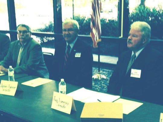 Candidates wait for a forum to begin Thursday in Pineville. From left are Rapides Parish Police Juror Richard Vanderlick; Rep. Jim Fannin, who is running for the Senate District 35 seat; and Jay Luneau, who is seeking the Senate District 29 seat.