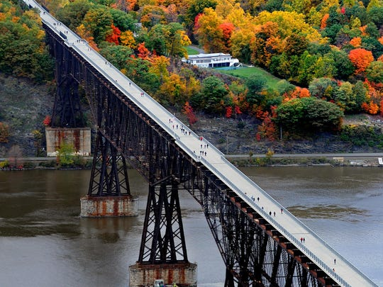This aerial view of Walkway Over the Hudson State Park looks west toward Highland. The former railroad bridge, which connects the William R. Steinhaus Dutchess Rail Trail in Dutchess County with the Hudson Valley Rail Trail in the Town of Lloyd, offers great views for fall foliage.