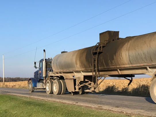 Semi tankers filled with manure rolled up and down