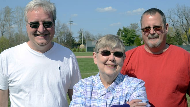 Steve Shelander, Mary Lynn-Shelander Dixon and her husband, Jeff, pose before Saturday's Lee Shelander Classic championship game. Lee and Mary were married only 18 months before Lee's death at age 26 in 1976.