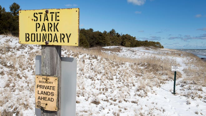 The northern boundary of Kohler-Andrae State Park as seen, Wednesday, March 7, 2016, in Sheboygan, Wis. The land posted private property belongs to the Kohler Company. The company is planning to build a golf course on property it owns.
