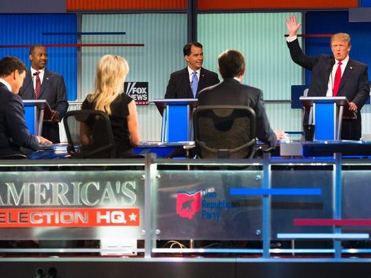 Donald Trump speaks to moderators Bret Baier, Megyn