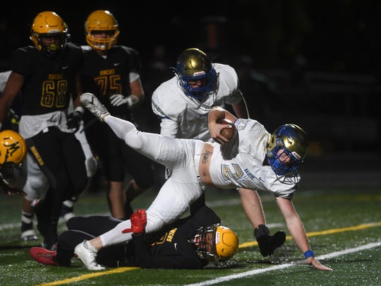 Reed's Champ Robertson (23) falls into the end zone for a touchdown against Bishop Manogue during their football game in Reno on Sept. 22.