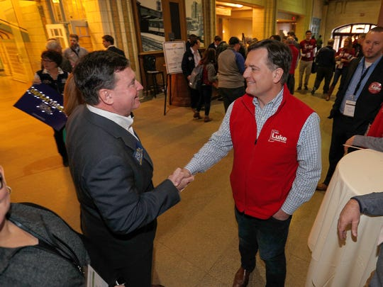 Congressman Todd Rokita,left, greets Congressman Luke Messer at the Indiana Republican Party's Congress of Counties U.S. Senate Straw Poll event at the Union Station Grand Hall Saturday, Jan 13, 2018.