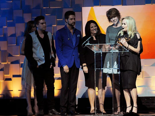 "Karen Peck & New River receive the Dove for Southern Gospel Recorded Song of the Year: ""Revival,"" at the 45th Annual GMA Dove Awards at Lipscomb's Allen Arena.