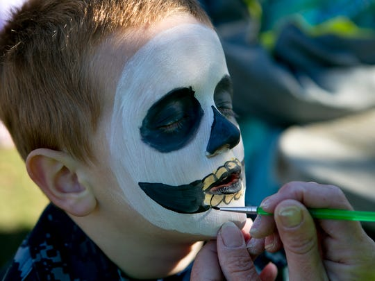 Shawn Leaders, not pictured, paints Gage Segalle-Mellenthin, 6, like a skeleton during trick-or-treat at Wildwood Zoo in Marshfield Saturday.